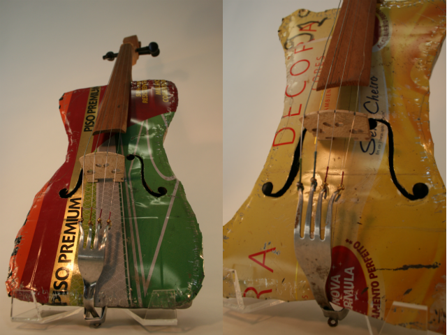 """Metal Glue cannister, fork, used strings, recycled wood and tunning pegs.   Nicolas """"Cola"""" Gomez, maker"""