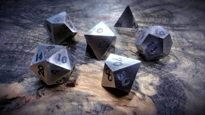 Prototype Stainless Steel Dice. All metal dice will use this font.