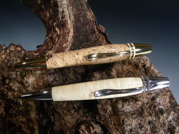 """Polaris Pen shown in Ambrosia Maple Burl with Gold Components and """"White"""" Box Elder with Rhodium Components"""
