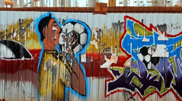 Graffiti drawn on the construction walls of the new stadium of Brasilia, the capital of Brazil