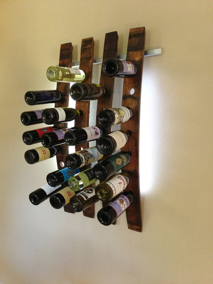 Lumi Wine Wall with 4 wine staves holding 28 bottles of wine includes all hardware, 96 SuperBright LEDs and four 12V wall transformers or four battery packs.  Once the project ends the retail price of the 4 Lumi Wine Wall will be $480.00.
