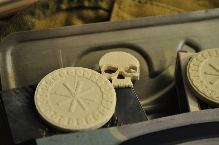 Skull chit and prototype poker chip