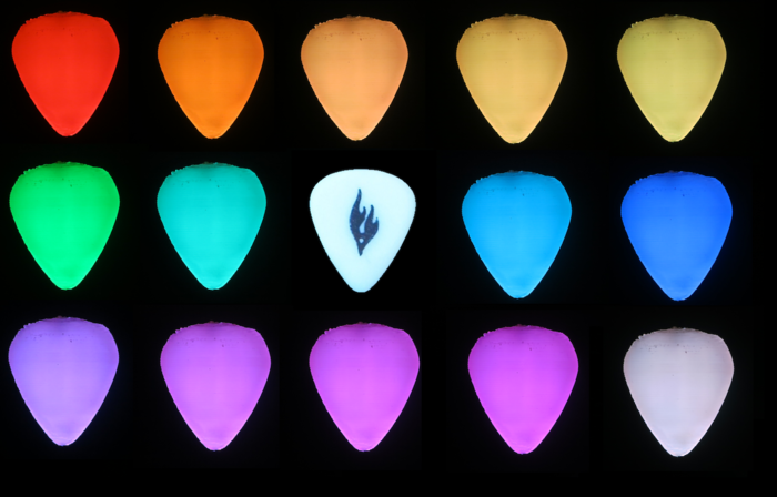 The Firefly Pick is always smooth white when unlit with internal LEDs, like the prototype in the middle.