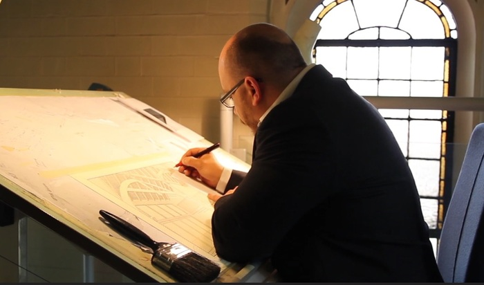 Jonathan Lees working on a Pen & Ink Drawing