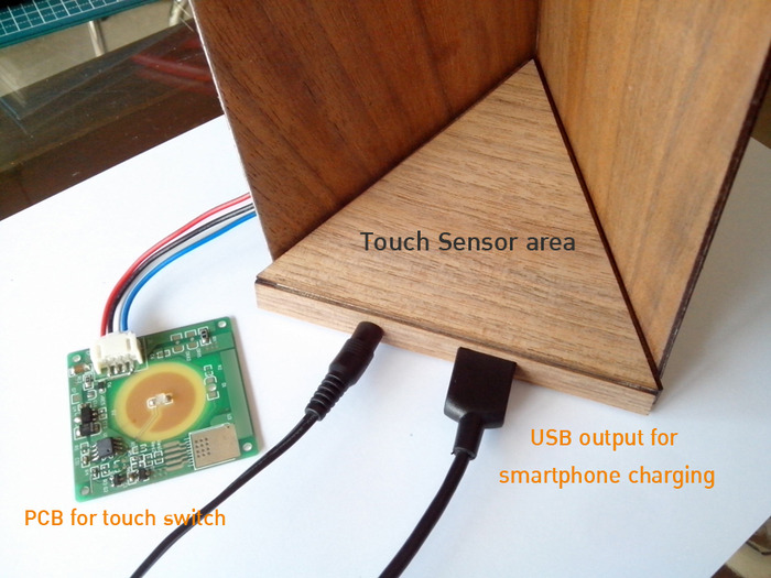 """The """"Arrow"""" lamp with lamp base attached with high power magnet and use as On/Off switch and USB. smartphone charger."""
