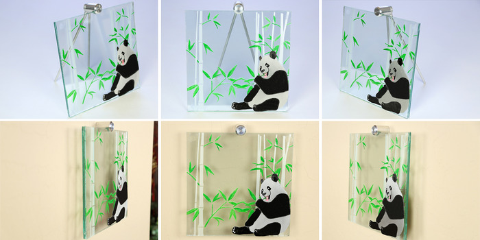 """Size: 10"""" X 10"""" X 2"""". The bamboo is engraved on the front of the glass with various leaves painted green.  The panda is cut out of aluminum material, anodized black, and then engraved to create white patches with additional paint added for final detailing"""