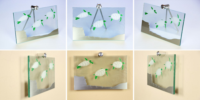 """Size: 11"""" x 7"""" x 2"""". Engraved sea turtles on the front of the glass with green painted accents.  A cut piece of line-grained aluminum creates the sea floor."""