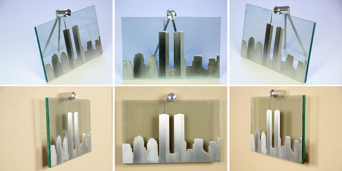 """Size: 11"""" x 7"""" x 2"""". The skyline is cut out of aluminum material with a line-grain sanding process to add characteristics to each building.  The antenna on top is sandblasted on the front of the glass and painted black."""