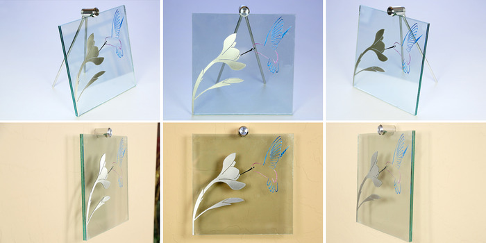 """Size: 10"""" X 10"""" X 2"""". An engraved hummingbird with painted accents on the front of the glass.  A cut piece of line-grained aluminum creates the flower."""