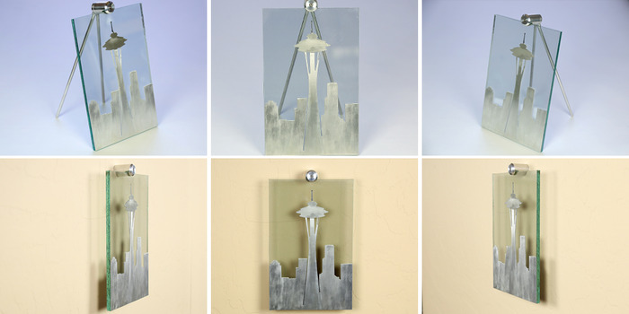 """Size: 7"""" x 11"""" x 2"""". The sky line is cut out of aluminum material with a line-grain sanding process to add detail.  The antenna on to is sandblasted on the front of the glass and painted black."""