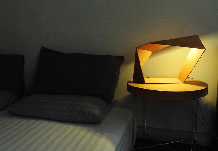"""Loop"" lamp at bedside."