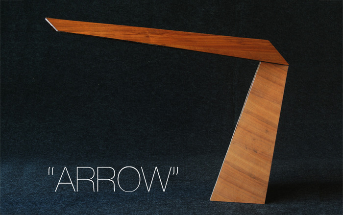 """The """"Arrow"""" LED task lamp (Walnut veneer) is for working or reading, and comes with a smartphone USB port to charge your battery."""