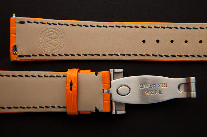watchstrap orange of Canopus watch from the back with patented exchange mechanism