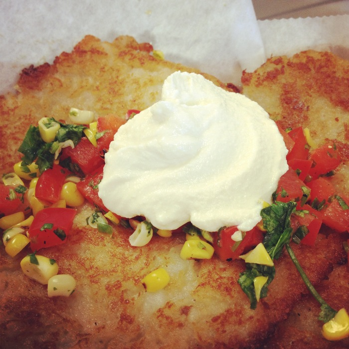 Funnomenom's potato pancakes (gluten free and vegan friendly)  topped with homemade vegan sour cream and roasted corn salsa