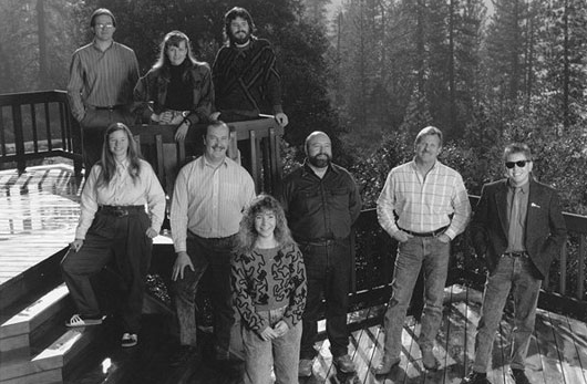 Jim Walls (second from right) with the early Sierra On-line design team.  Company co-founder Roberta Williams in front.