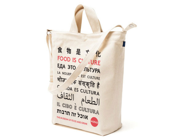 "Tote Option 1: ""Food is Culture"" written in Mandarin, English, Russian, French, Hindi, Spanish, Arabic, Italian, and Hebrew."
