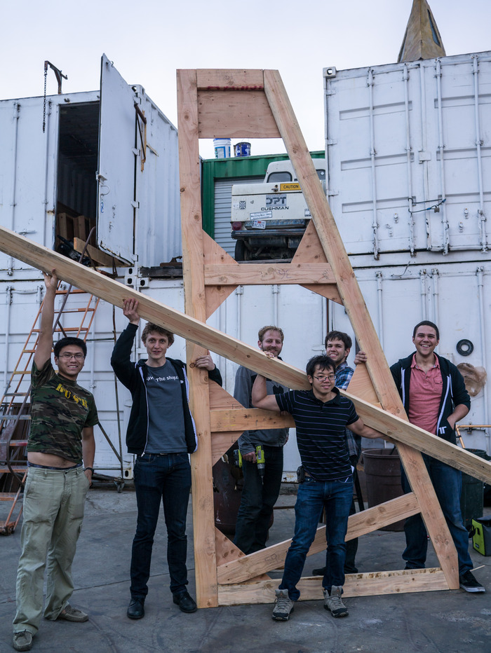 About few members of the group, working on structural supports.