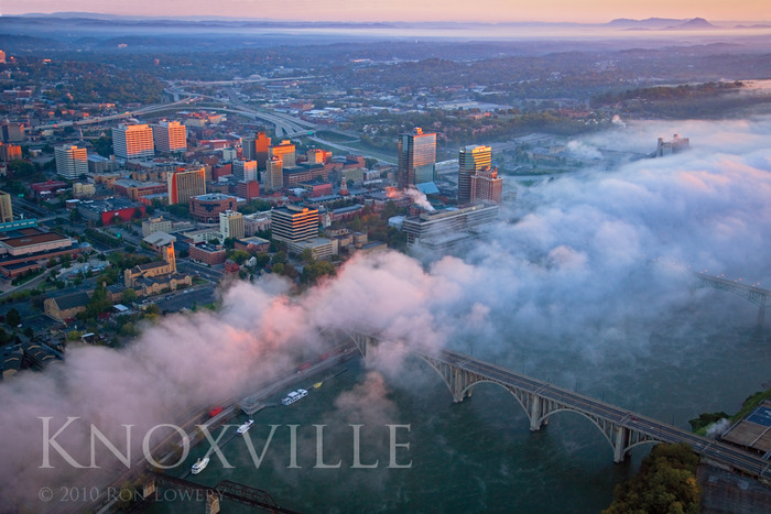 Early morning fog breaks up over Knoxville as sun turns the buildings to gold.