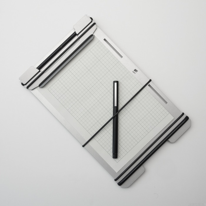 SMALL BANDBOARD WITH PEN AND FOLDED PAPER