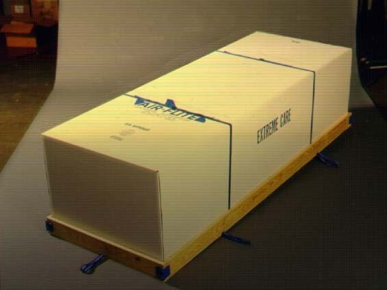 The deceased is portrayed as a casket shipping container, basically an oversized cardboard box