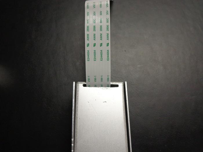 Vertical orientation ribbon cable slot