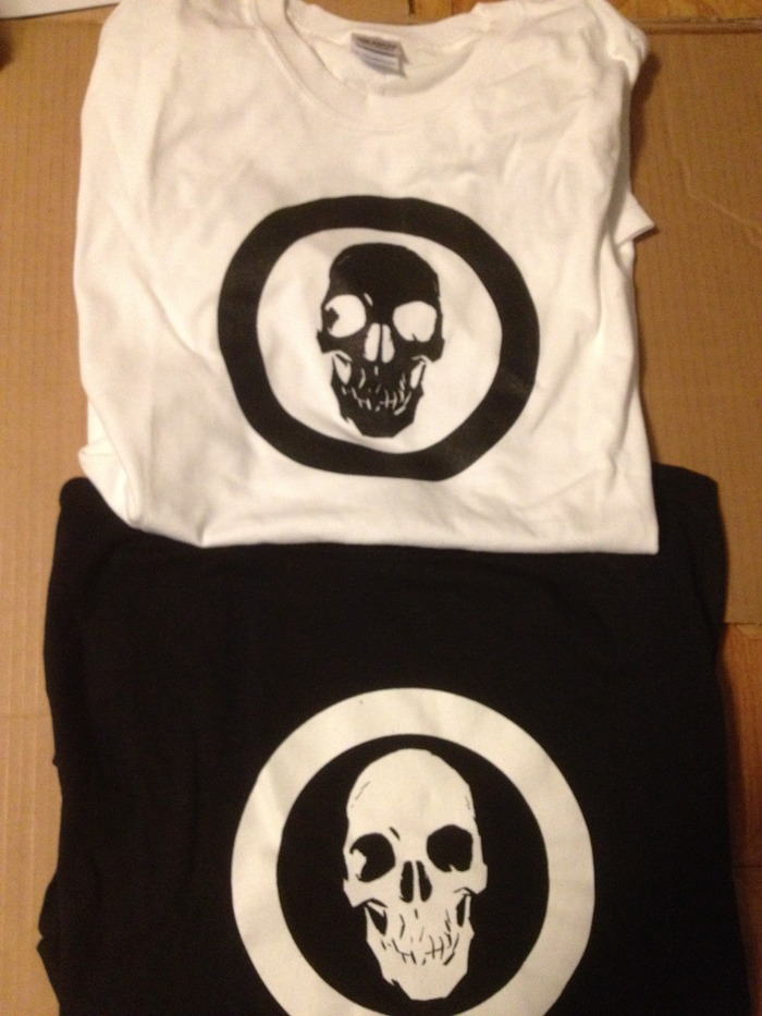 Doc Unknown T-Shirts! Skull on front, Doc Unknown logo on the back, your choice of either black or white.