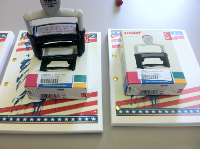 """Step 5. To accompany the bound formal reply, we also inclosed a Trodart Model 5208 professional grade self-inking rubber stamp with red ink and the saying """"If a law isn't public, it isn't a law. Justice Stephen Breyer."""""""
