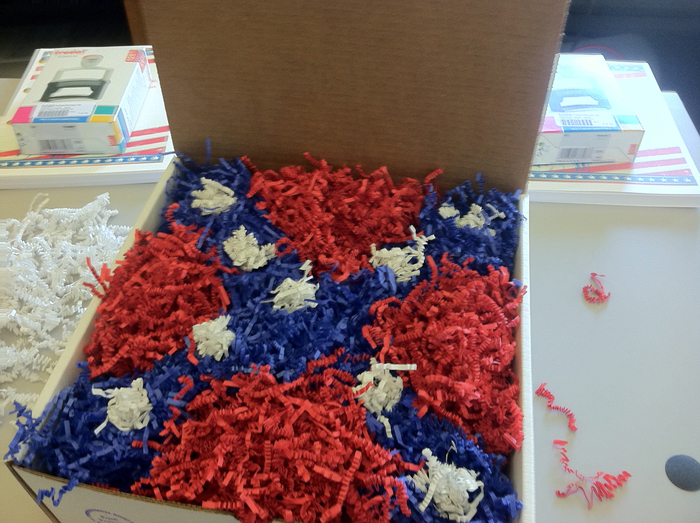 Step 6. The reply and the rubber stamp are enclosed in a white box, and then red, blue, and white crinkle-pak is used to create an image of the Mississippi flag.