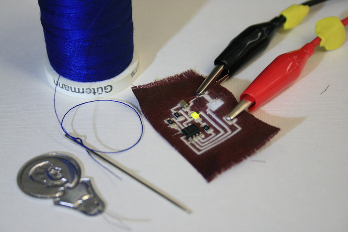 Flashing LED circuit printed on synthetic fabric