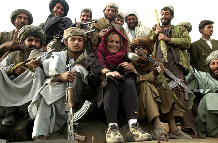 On my first trip to Afghanistan in late 2001, local militia pose with me on top of a tank outside of Kandahar.