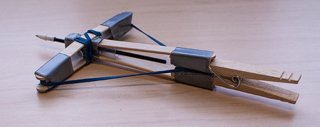 (OK, so we'll tell you about this one... It's a Clothespin Crossbow!)