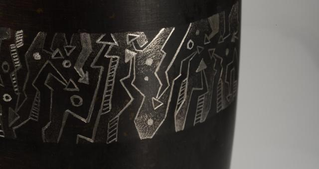 engraving trial on a black oxide coated mug