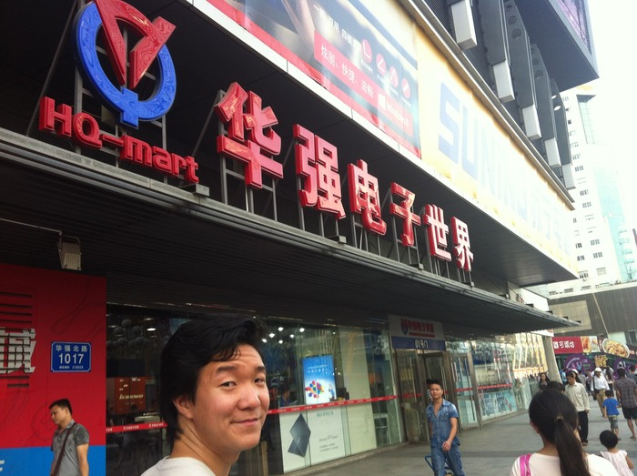 Calvin in front of HQ Mart in Shenzhen, China The Electronics Capital of the World.