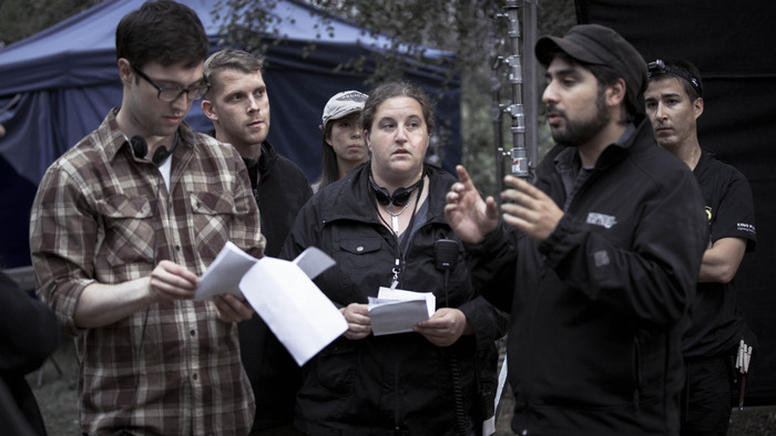 (left to right) director Braden Croft, producers Adrian Salpeter & Liz Levine, hair/makeup artist Joyce Tu, gaffer Corey Jacques, cinematographer Naim Sutherland discuss an upcoming set up on Day 2 of production