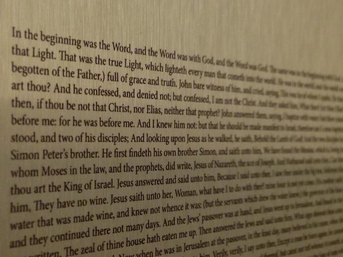 Close-up of the Gospel of John on Aluminum