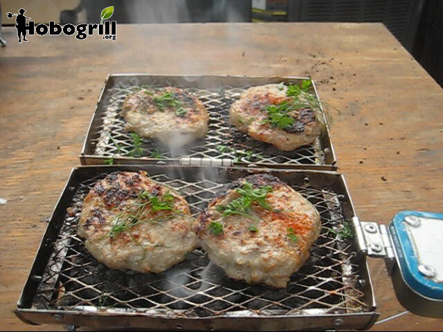 Double sided cooking is possible with all Hobogrill HG2 series grills.  Turkey burgers for two garnished with parsely and paparika