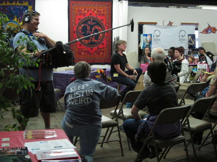 Radclyffe (Len Barot) talking to readers at the LesFic Festival in Austin, Texas