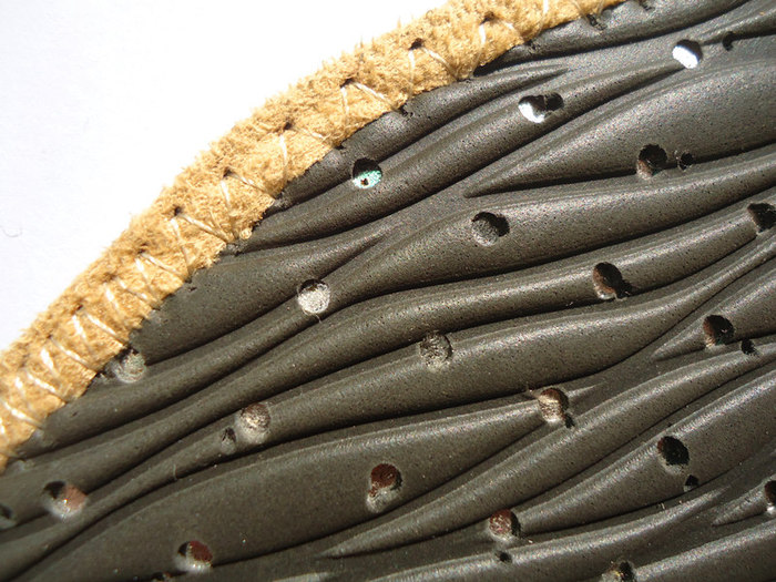 bottom of the sole-sock: Groove to help air flow and grip, air hole for breathablity.