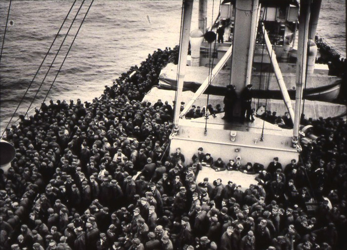 Thousands of German POWs are transported on an American ship to prison camps in the United States.