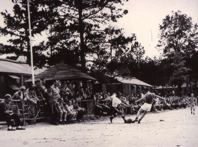 German POWs play soccer at an American prison camp.