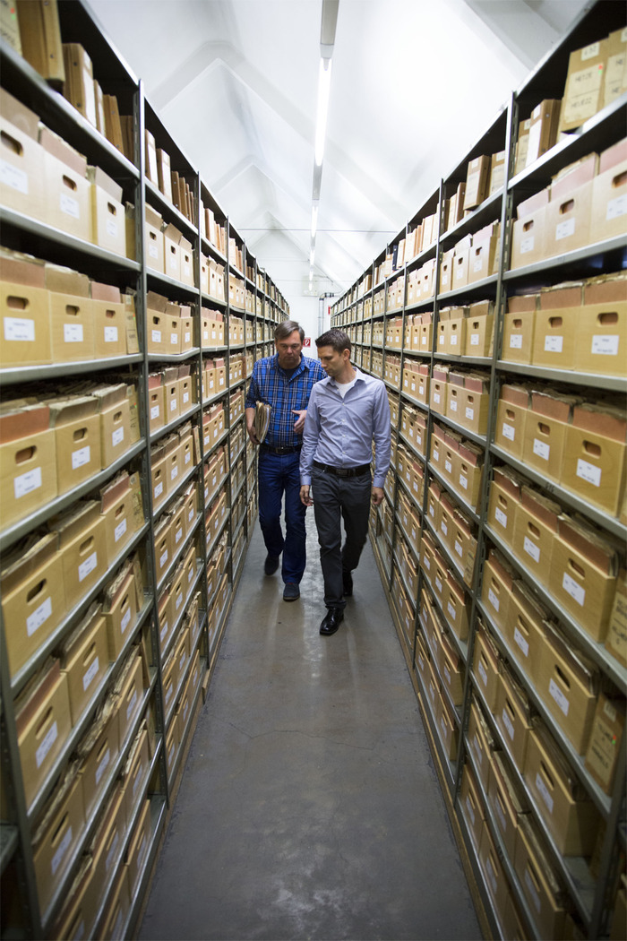 After filming documents for the film, Scott Porter (Producer) and Stephan Kuehmayer (Researcher, WASt) talk as they walk through the isles of more than 2.1 million WWII German POW records in Berlin.