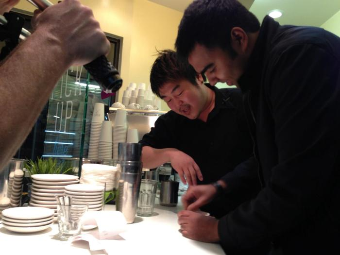 Rock being taught how to stir a latte by Tommy.