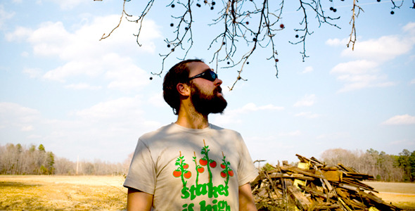 In case it's hard to see, this farmer's clever t-shirt says 'stakes is high'