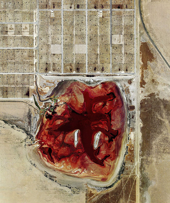 Photographer Mishka Henner documented factory farm pollution—like this waste lagoon at a Texas feedlot—by satellite. What else could drone photography uncover?