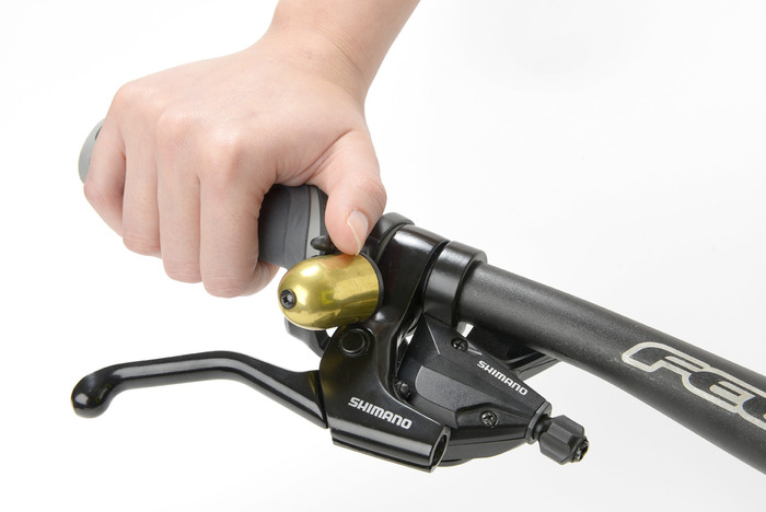 Trigger Bell fitted on trigger shifter. Note it's above the handlebar on the right hand side and still more accessible than a traditional bell
