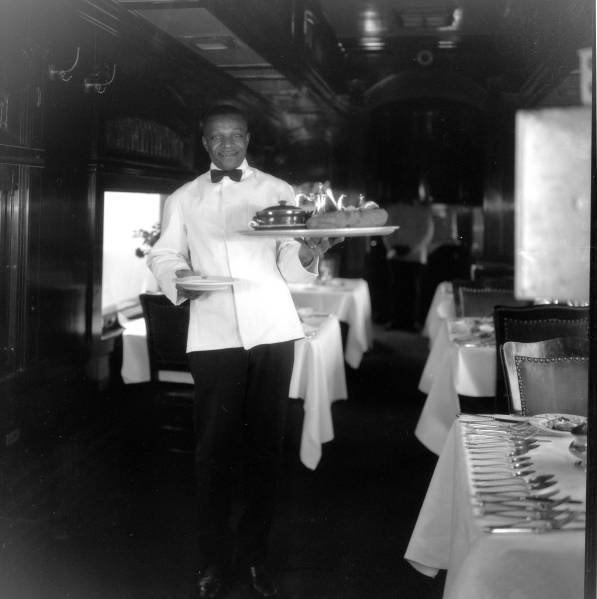 """Dining Car waiter brings out another famous """"GREAT BIG BAKED POTATO"""""""