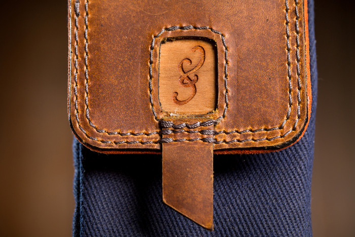 Parachute grade stitching with a real cherry wood ampersand