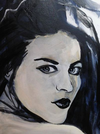 This is Francis Bean Cobain, Kurt's daughter.  She is the bottom right panel of the Kurt Cobain piece.