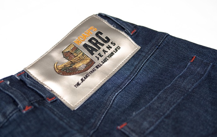 ARC Jeans label, note: previous label shown (to be updated with the removal of 'Noahs' & slogan. (Refer to new label above)
