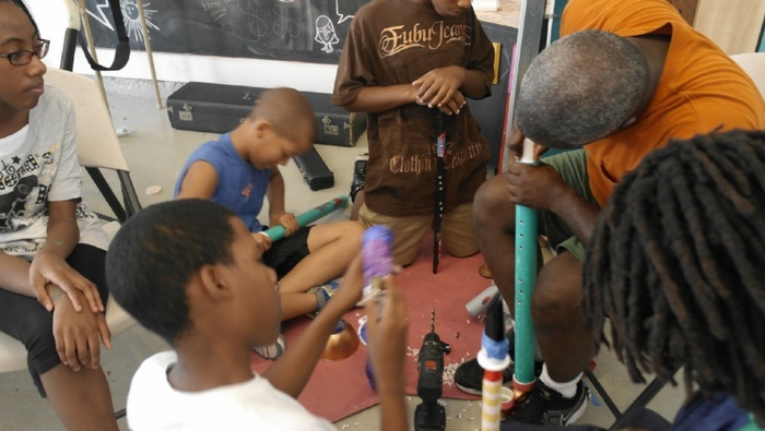Participants from the free instrument building workshop at Project Row Houses